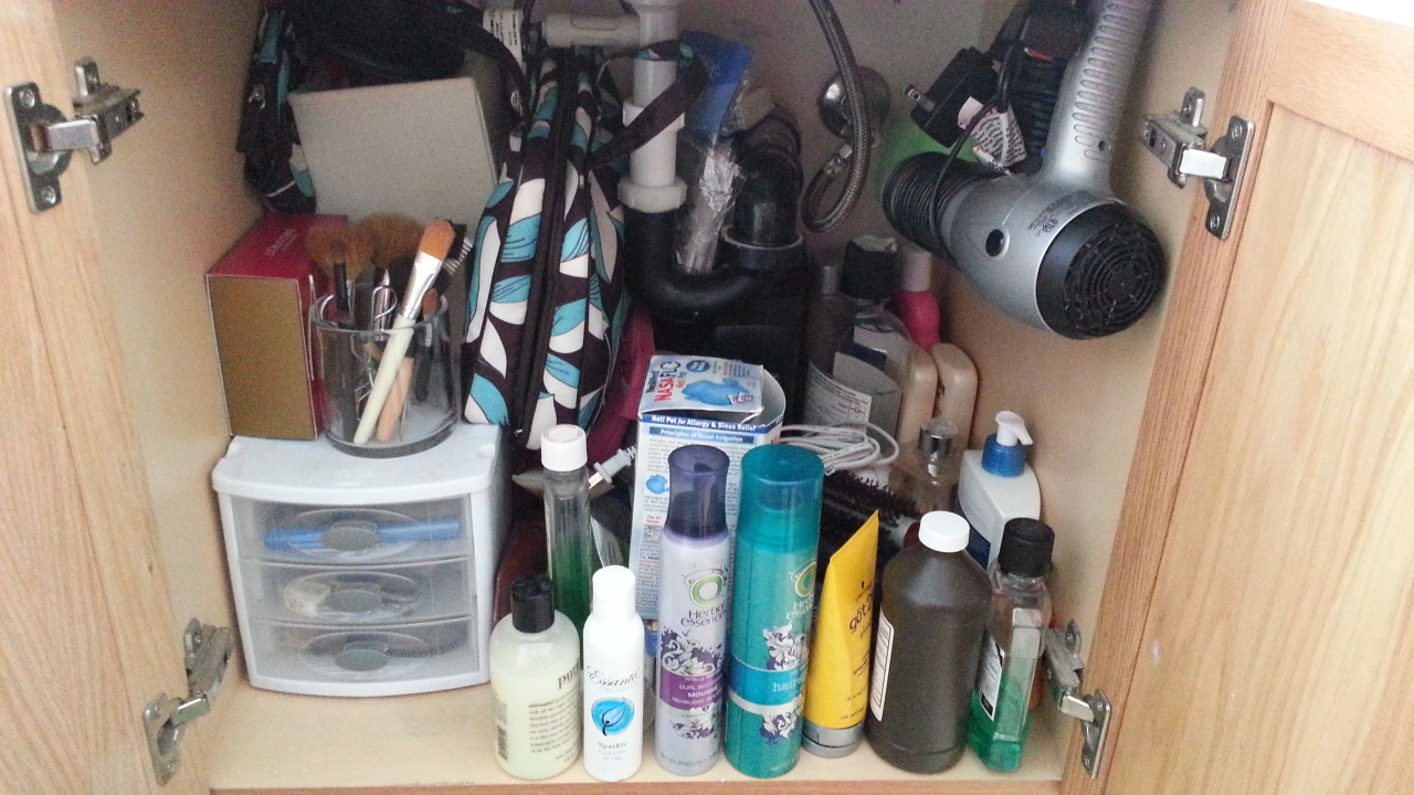 messy bathroom cabinet